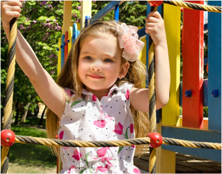 child on swing at happy days cdc